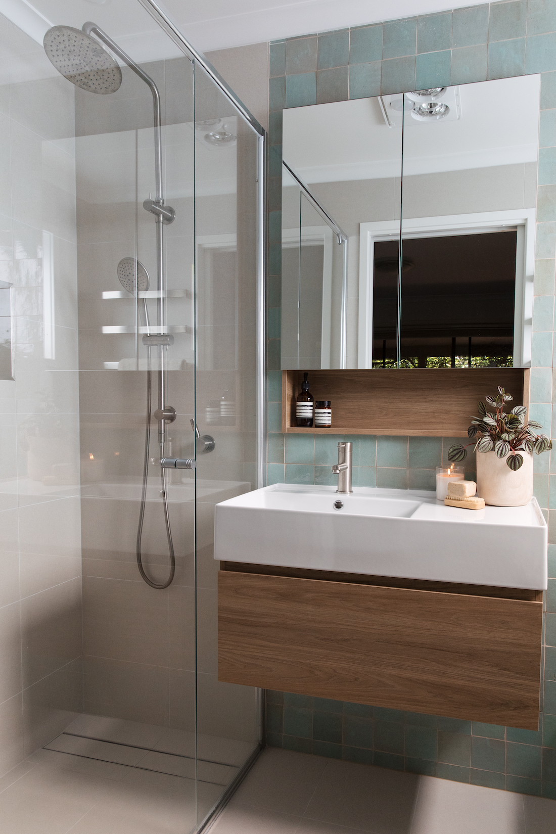 Calming ensuite with floating timber vanity