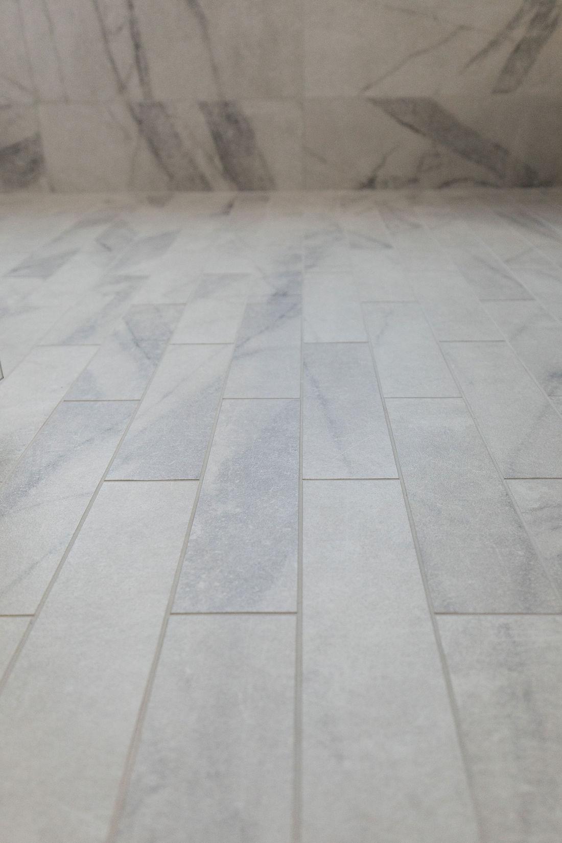 Marble-look bathroom subway tile floor