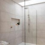 Warm tonal bathroom large walk in shower