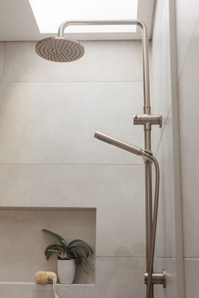 Warm stone look tiles with two in one shower
