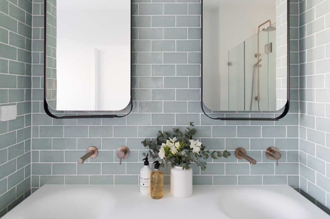 Blue subway tile bathroom Double black frame mirrors