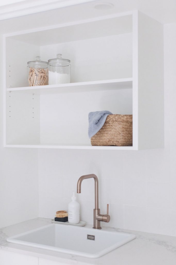 White open shelving in laundry