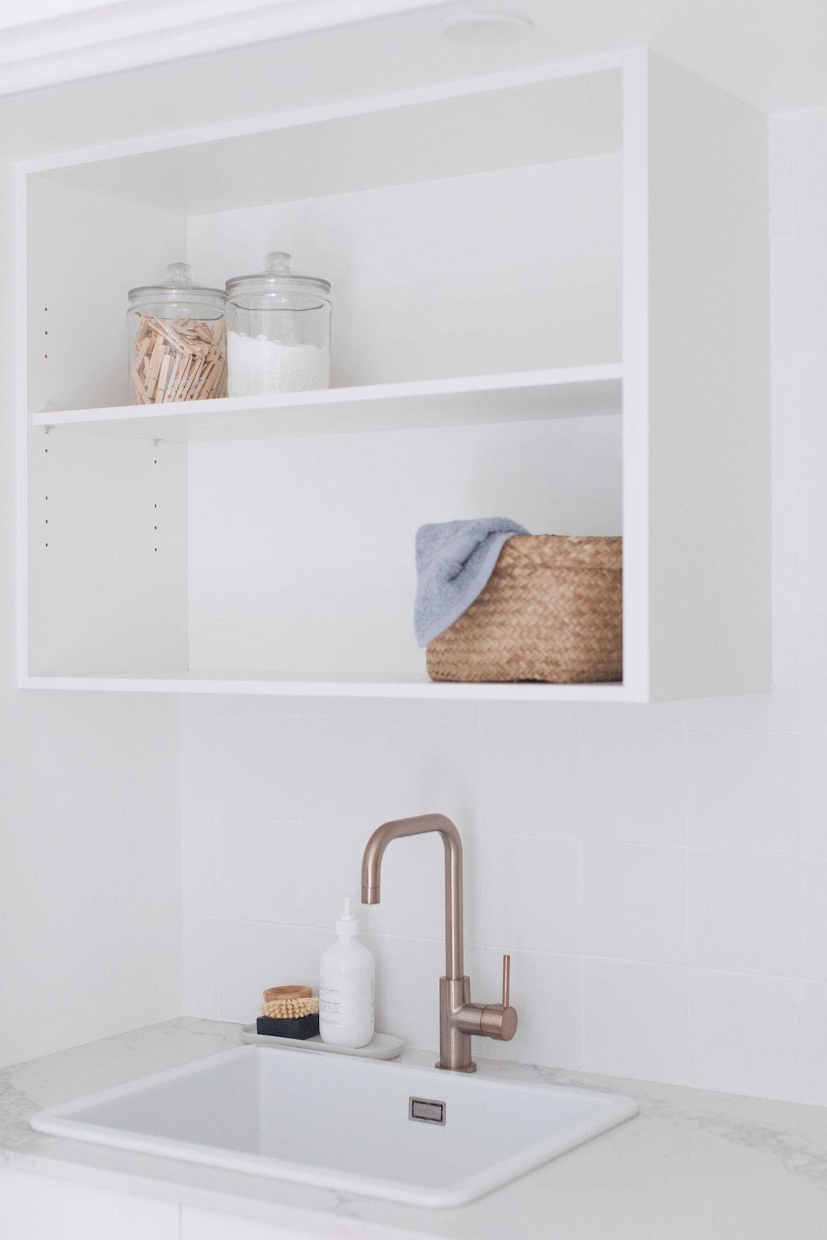 White open shelving in laundry