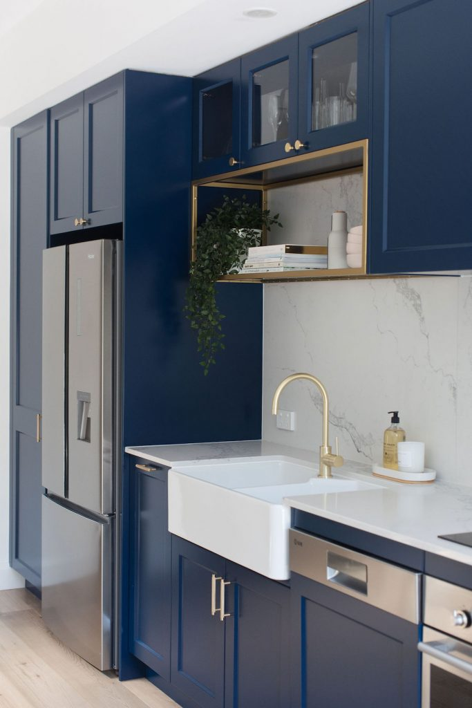 Blue shaker style kitchen Gold tap