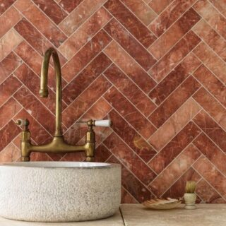You'll find us in our French chateau with this stunning tile designed by @sibellacourt 😍 This elegant marble with its array of reds, is a gorgeous feature to add to into your home.   Come and see them in our showroom to start creating your own personal chateau 😉