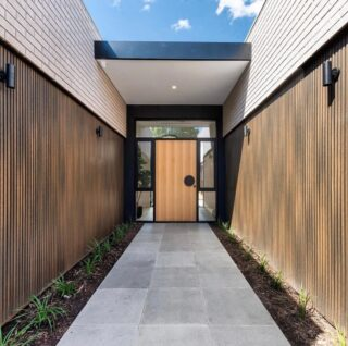 We are still obsessing over this beautiful entrance! We would be skipping home 😍   @statusliving and @studio_187 bringing dreams to life!  • • • • • #homeentrance #inspiration #entrance #walkway #frontdoor #bigfrontdoor #wooddoor #wood #timber #tiles #floortiles #exteriortiles #greytiles #house #frontofhouse #brickwork #bricks #bigwindows #path #plants #australia #canberra #canberradesign #housedesign #renovations #reno #blackfinishes #modernhome #modernhouse #canberrahomes