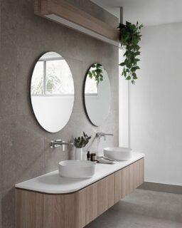 Tonal bathrooms are having a real design moment and the ladies at @zephyr_stone show how it's done in this dreamy space 😍  #bathroomdesign #bathroominspiration #bathroominspo #curvedvanity #roundmirror #bathroomideas #chrometapware #abovemountbasin #greybathroom #contemporarybathroom