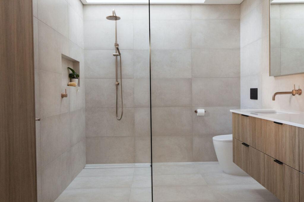 Warm stone look tiles in bathroom